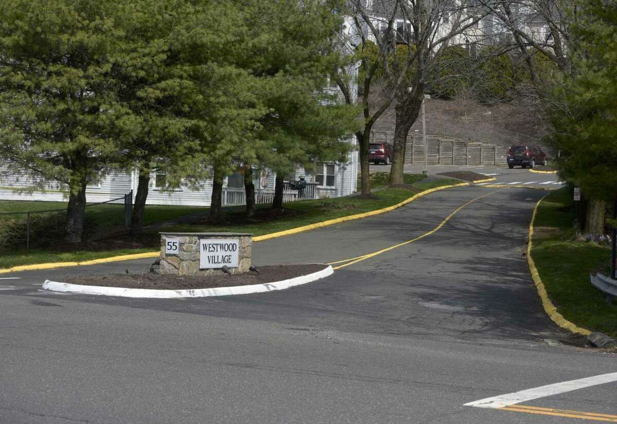 The entrance to the condo complex at 55 Mill Plain Road in Danbury, Conn., the day after the body of Todd Smith was found submerged in a retention pond on the property the evening of April 8, 2021.