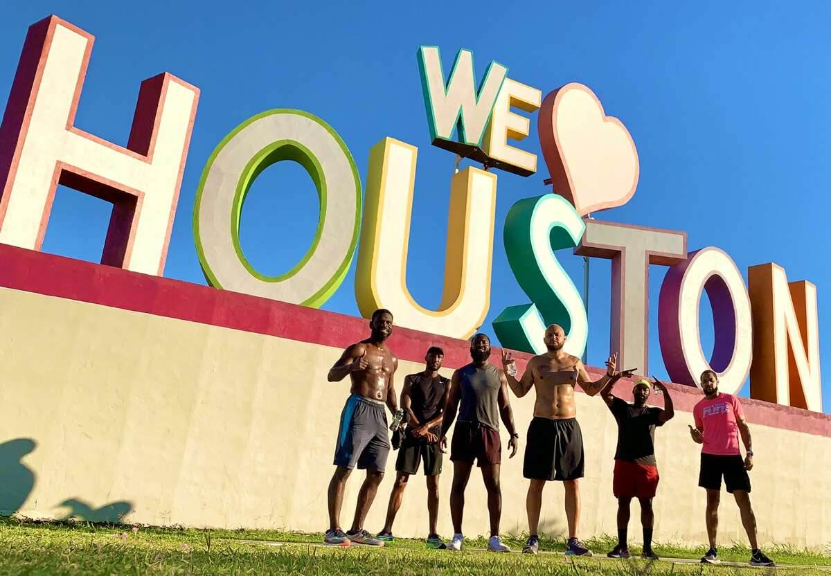 Members of Black Men Run in front of the We Heart Houston sign, including Terry Love, far right.