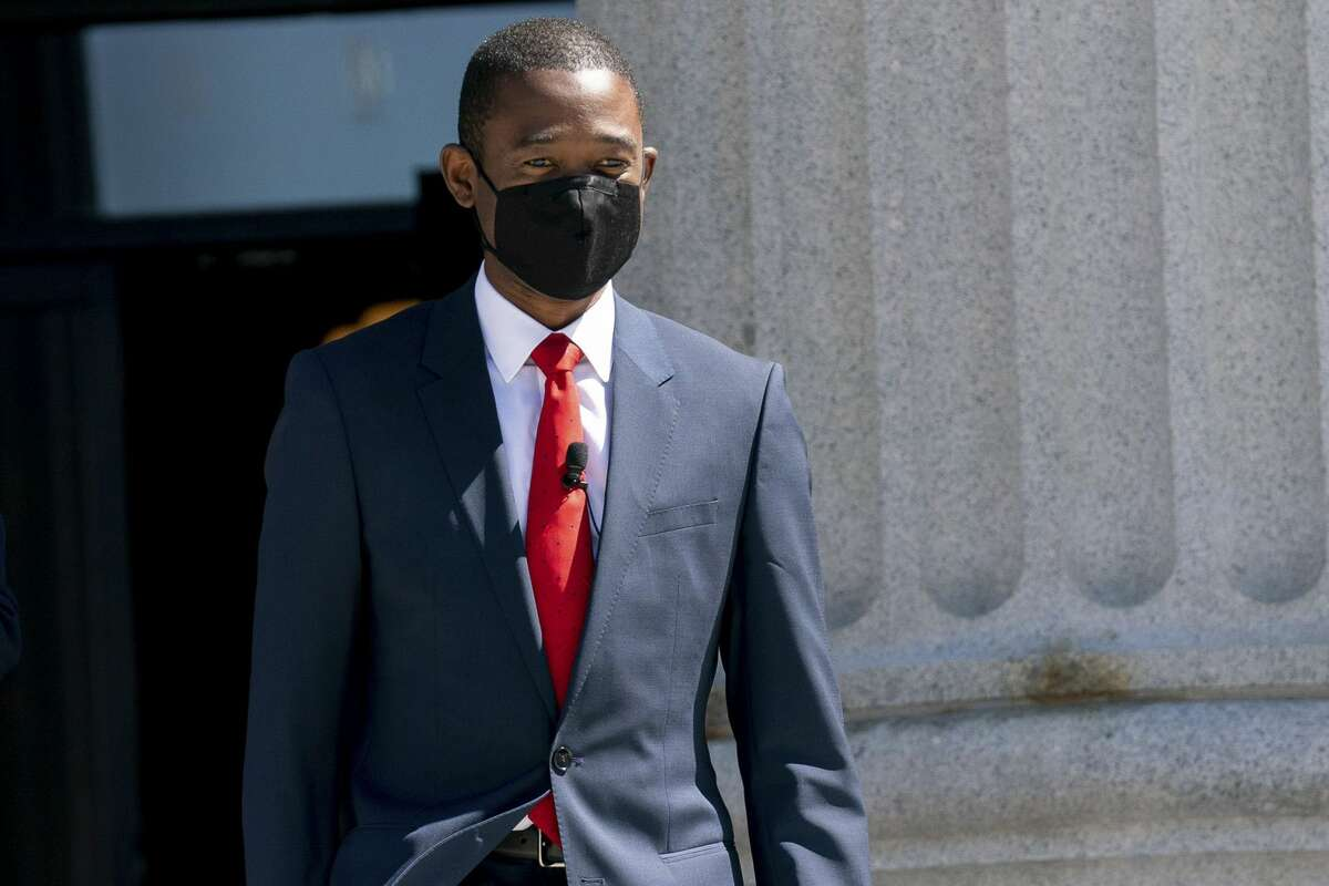 Wally Adeyemo, deputy U.S. Treasury secretary, wears a protective mask while arriving before a swearing in ceremony at the Treasury Department in Washington on March 26, 2021.