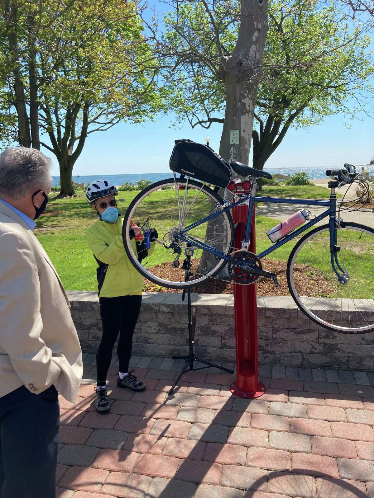 Demonstration on how to use the free bike repair station at Calf Pasture Beach on Friday, May 7.