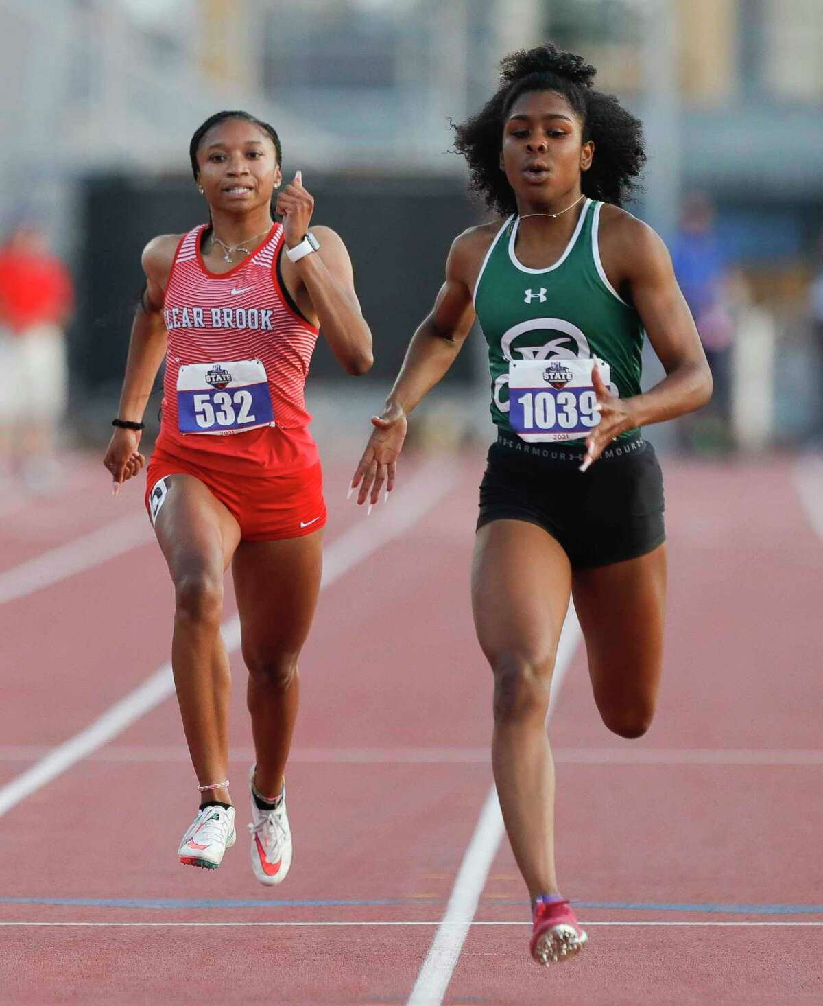 Camryn Dickson of Clear Brook (left) competes in the girls 200-meter dash during the Class 6A UIL Track and Field Championships at Mike A. Myers Stadium, Saturday, May 8, 2021, in Austin.