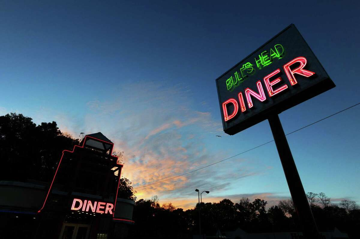 The sun rises behind the Bull's Head Diner in Stamford, Conn. on Sunday, Nov. 6, 2016.