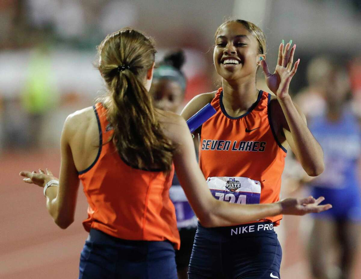 Seven Lakes' Haley Tate (right) celebrates after her team won the girls 4x400-meter relay Saturday at the state track and field meet in Austin.