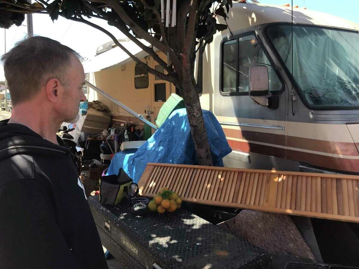 Ron Trathen stands outside his motor home parked on Bayshore Boulevard.