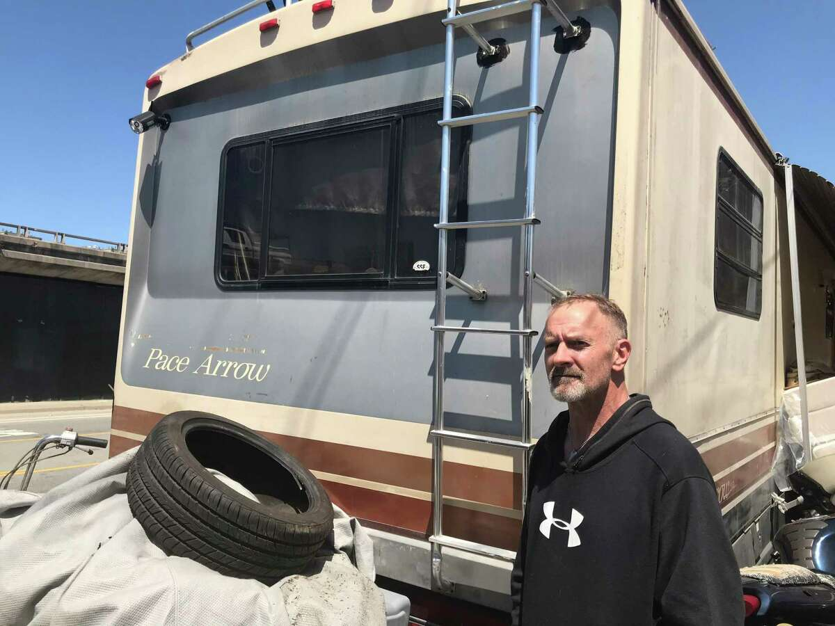 Ron Trathen outside his motor home parked on San Francisco's Bayshore Boulevard. Trathen recently had two vehicles towed by the city for expired registration. The city will resume enforcing some towing violations May 17.