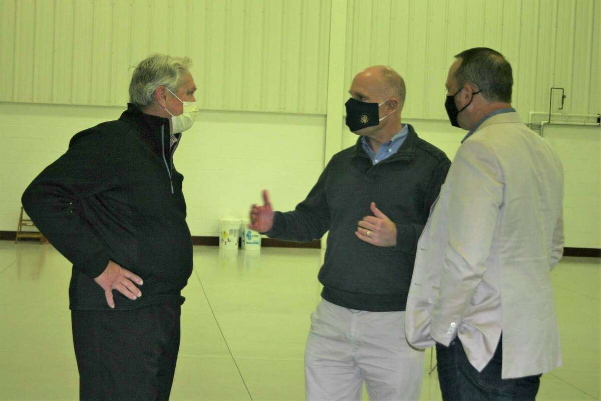 Mecosta County Development Corporation director Jim Sandy (right), along with local business leaders and city officials, metwith Rep. John Moolenaar (center)to discuss the proposed Roben-Hood Airport runway expansionFriday. (Pioneer photo/Cathie Crew)