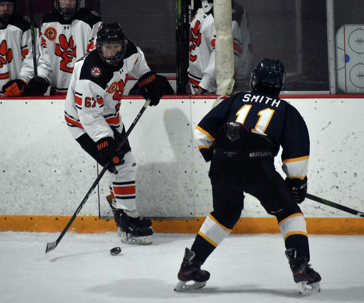 Edwardsville's Adam Leston skates in front of his bench with the puck against the O'Fallon Panthers during the second period inside the East Alton Ice Arena.