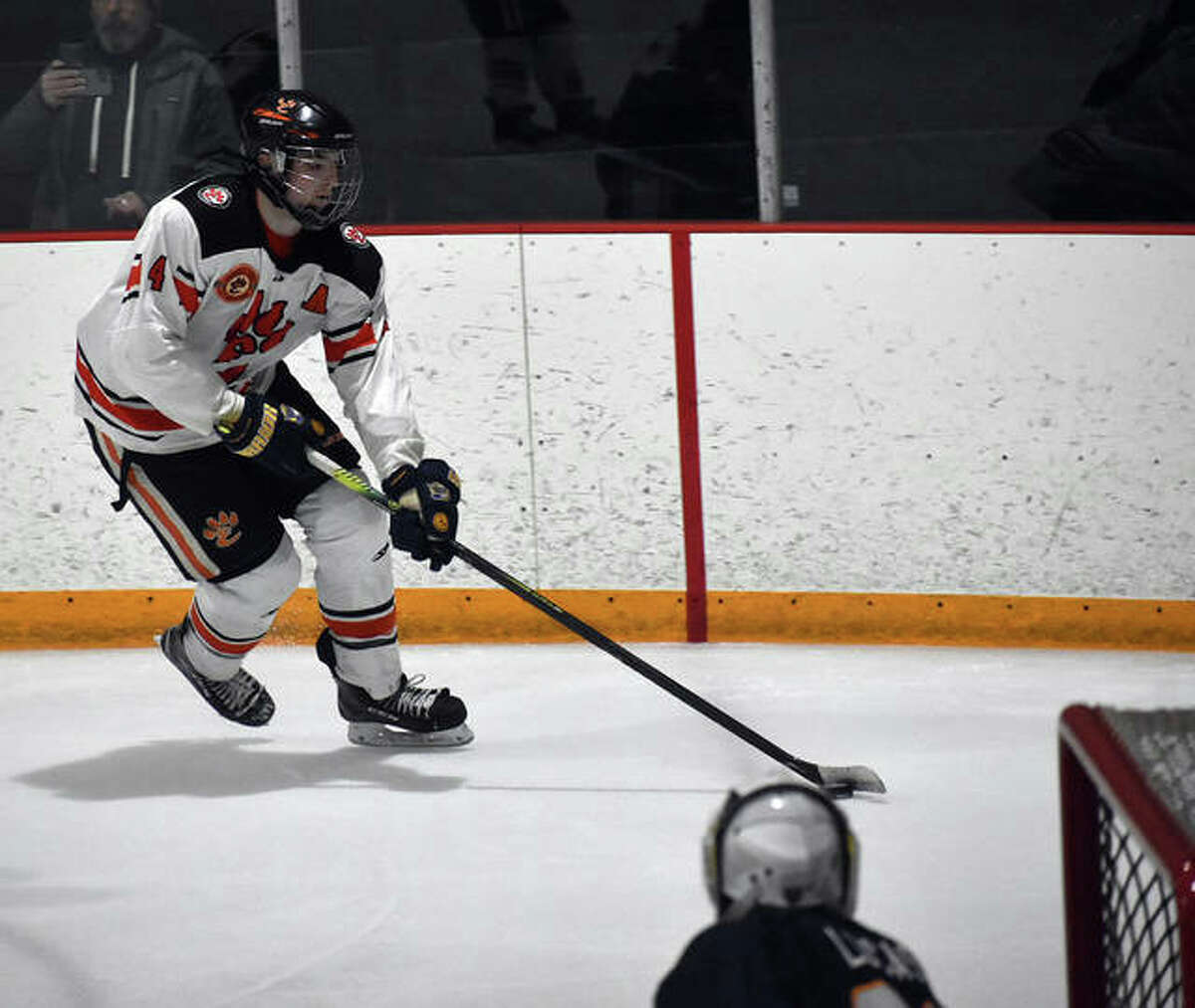 Edwardsville's Parker Terch skates towards the goal after collecting the puck near the boards in the second period against O'Fallon inside the East Alton Ice Arena.