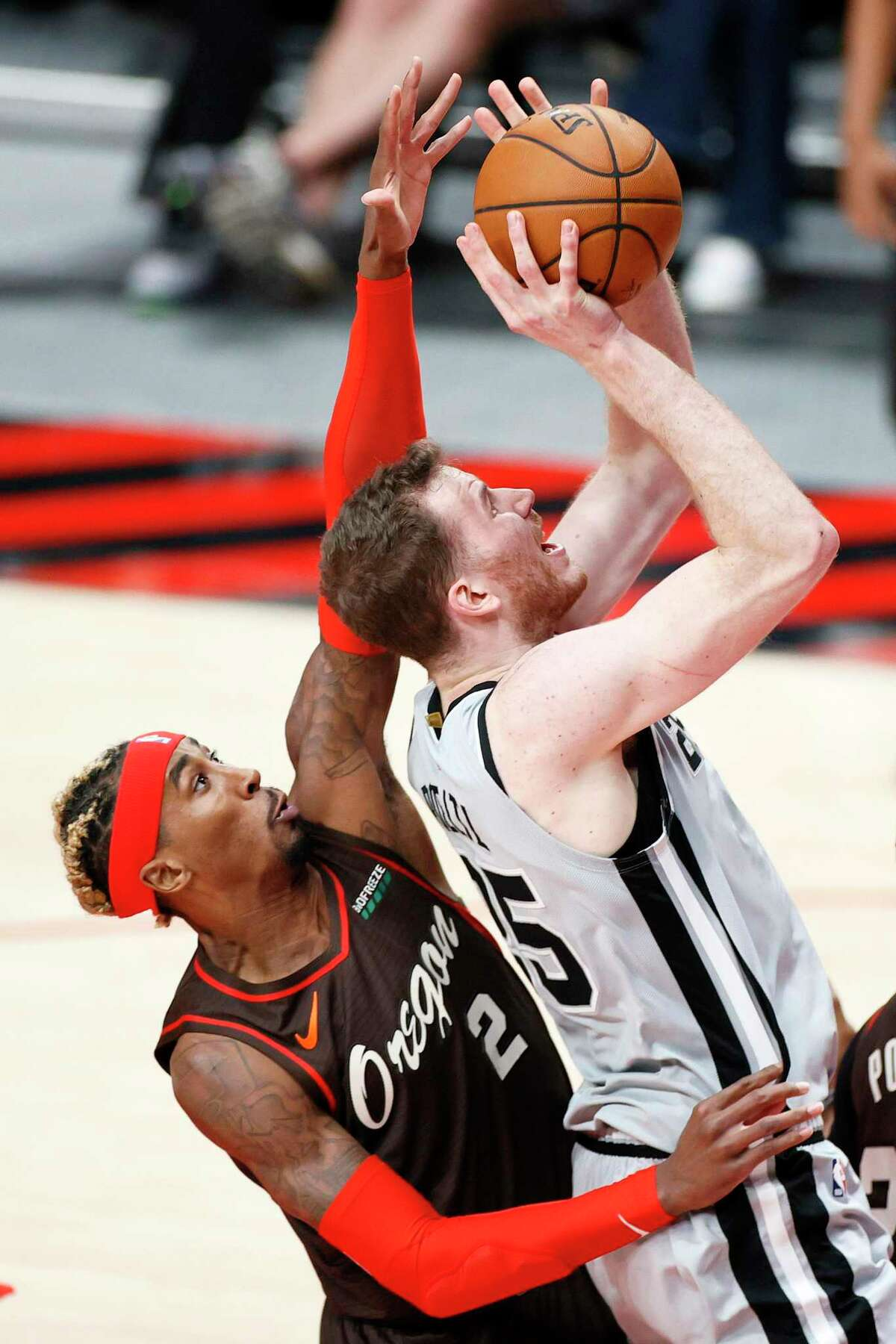 Rondae Hollis-Jefferson (2) of the Trail Blazers defends Jakob Poeltl of the Spurs during the second quarter at Moda Center on May 8, 2021 in Portland, Ore.