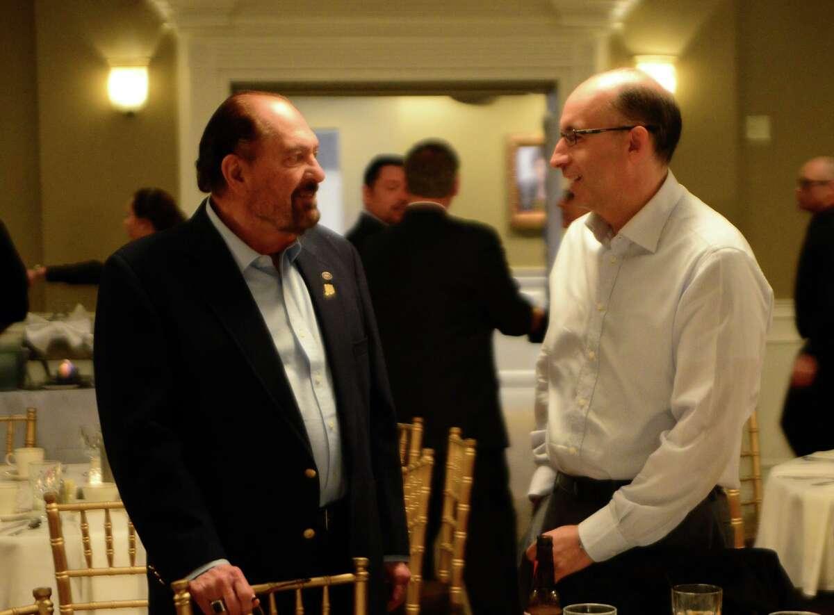 Larry LaConte, left, speaks with Ben Fronsaglia of Shelton at a 2014 fundraiser for Shelton Mayor Mark Lauretti's gubernatorial campaign.