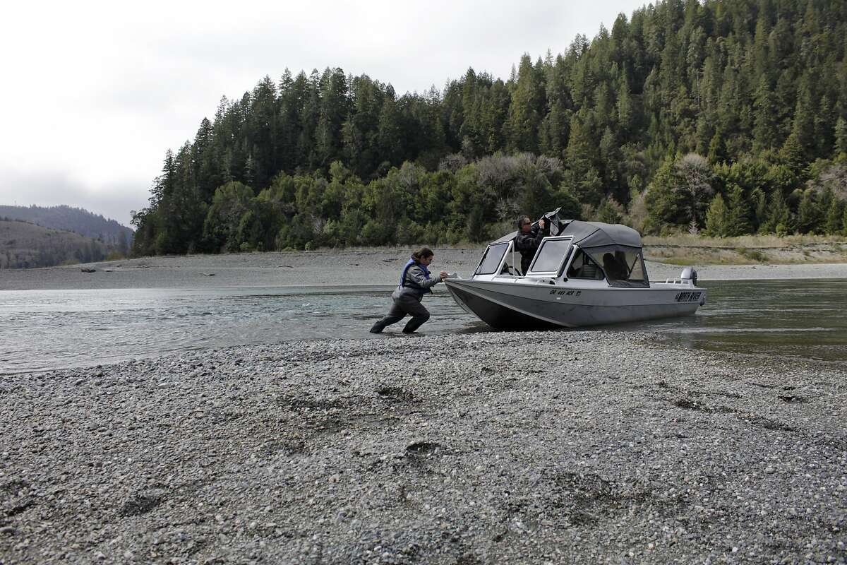 Yurok fish technician Hunter Maltz pushes a jet boat into the low water of the Klamath River in Humboldt County in 2020. Gov. Gavin Newsom has declared a drought emergency for an additional 39 California counties, bringing the number to 41 of California's 58 counties under drought declaration.