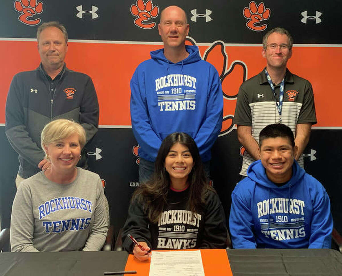 Edwardsville senior Chloe Trimpe, seated center, will play tennis at Rockhurst University in Kansas City, Missouri. She is joined in the picture by her mom Dina, seated right, brother Zach, seated left, EHS coach Dave Lipe, standing left, dad Trevor, standing center, and EHS assistant coach Kirk Schlueter. Not pictured is sister Grace Trimpe.