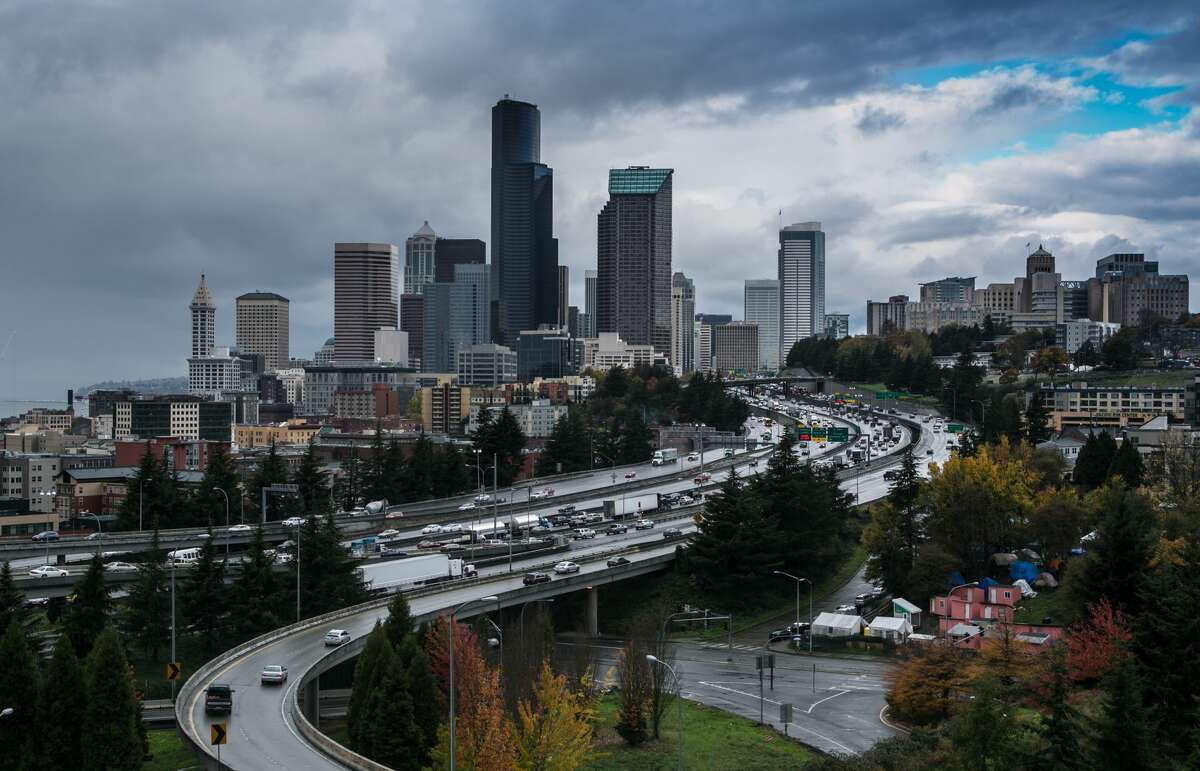 SEATTLE, WA - NOVEMBER 3: The downtown skyline is shrouded in rain and clouds on November 3, 2015, in Seattle, Washington. Seattle, located in King County, is the largest city in the Pacific Northwest, and is experiencing an economic boom as a result of its European and Asian global business connections. (Photo by George Rose/Getty Images)