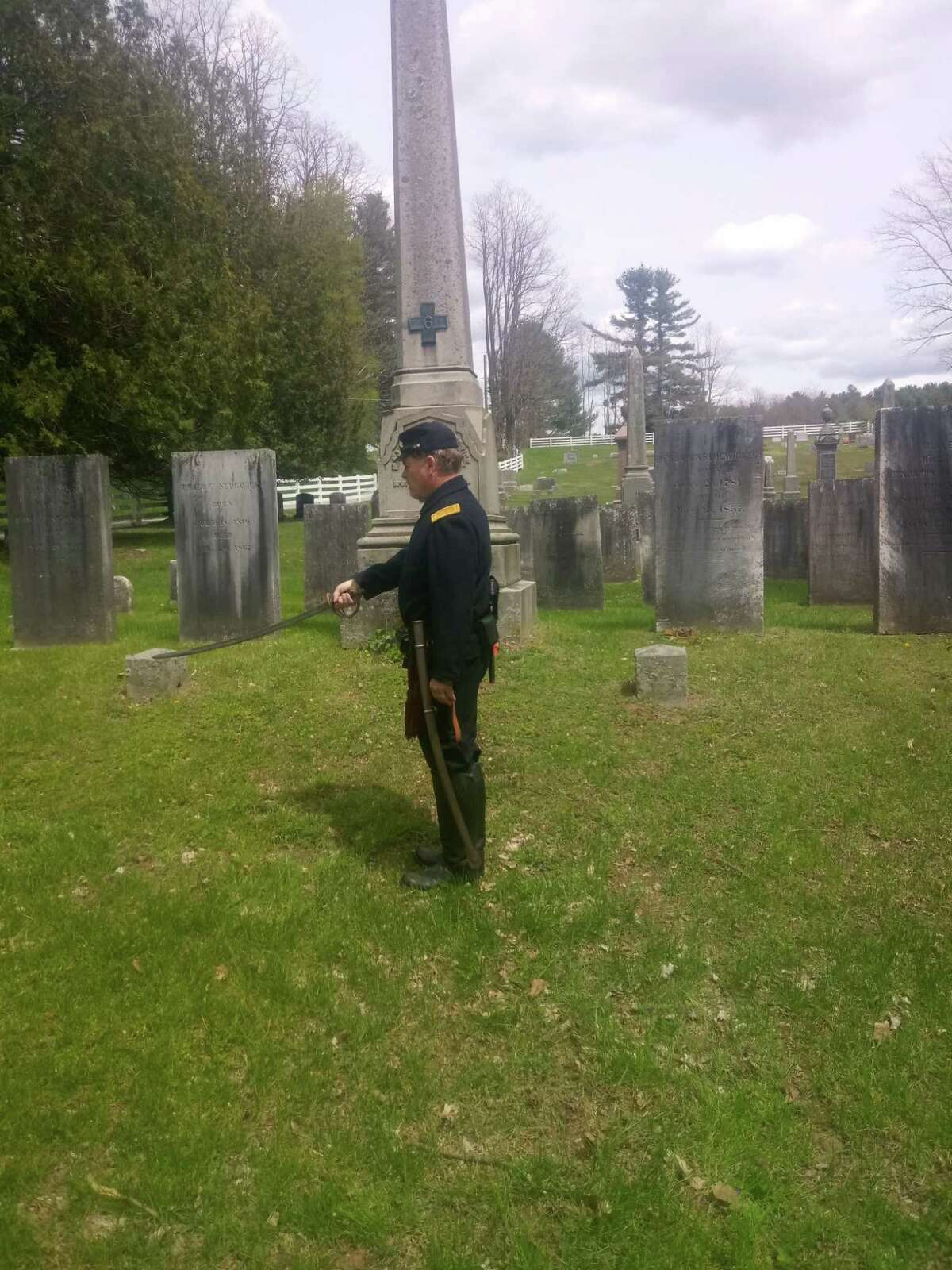 Civil War reenactor Kevin Titus honored U.S. Army Major John Sedgwick Sunday. Sedgwick, who served in the Union Army and was killed in action in 1864 in Spotsylvania, VA, is buried at Old Cornwall Hollow Cemetery. Above, Titus in uniform at the grave.