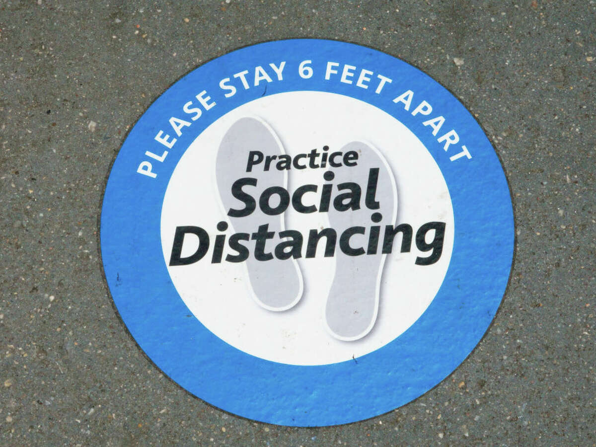 Practice Social Distancing sticker on sidewalk, Chaswe Bank, New York City.