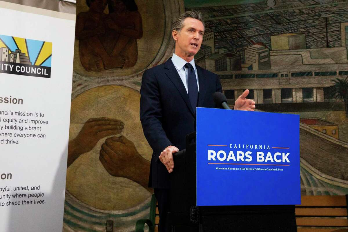 Governor Gavin Newsom addresses the crowd during a press conference held at Unity Council career center in the Fruitvale neighborhood of Oakland, Calif. Monday, May 10, 2021. Governor Newsom is starting a week of budget rollout, announcing that California has a $75.7 billion surplus, which finance officials project will give the state about $38 billion in discretionary spending.