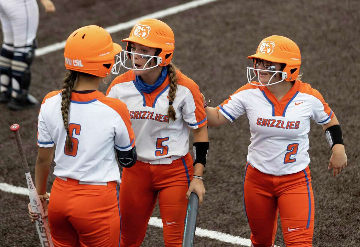 Savannah Pemberton #5 of Grand Oaks and Alle Hagebusch #2 speak with Kourtney Bellinger #6 after they score during the fourth inning in a one-game Region II-6A area round playoff against Klein Collins at Humble High School on Friday, May 7, 2021, in Humble.