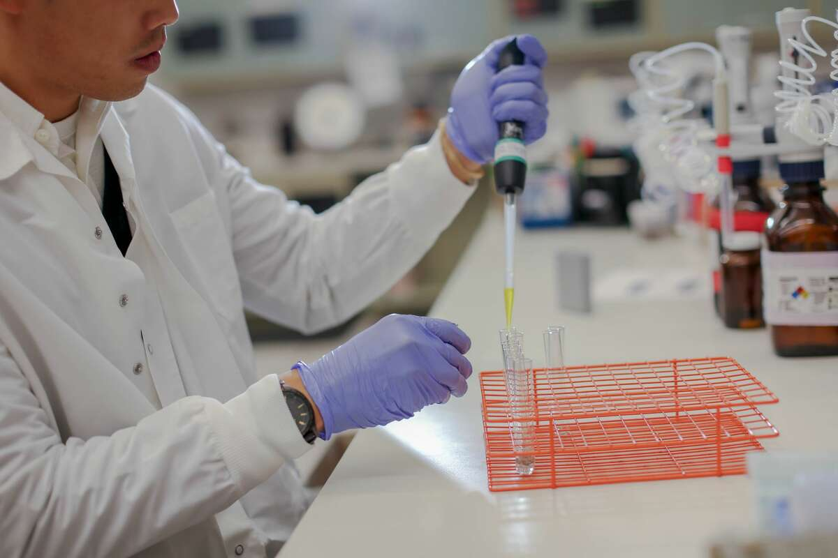 An employee performs testing in a lab for Quest Diagnostics. (Provided photo)