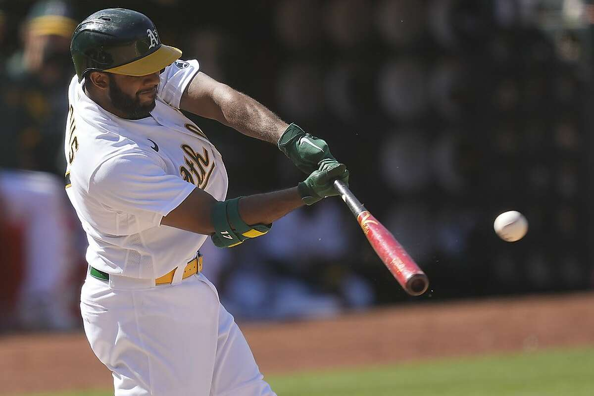Oakland Athletics' Elvis Andrus (17) hits a double to drive in a run against the Tampa Bay Rays during the eighth inning of a baseball game Saturday, May 8, 2021, in Oakland, Calif. (AP Photo/Tony Avelar)