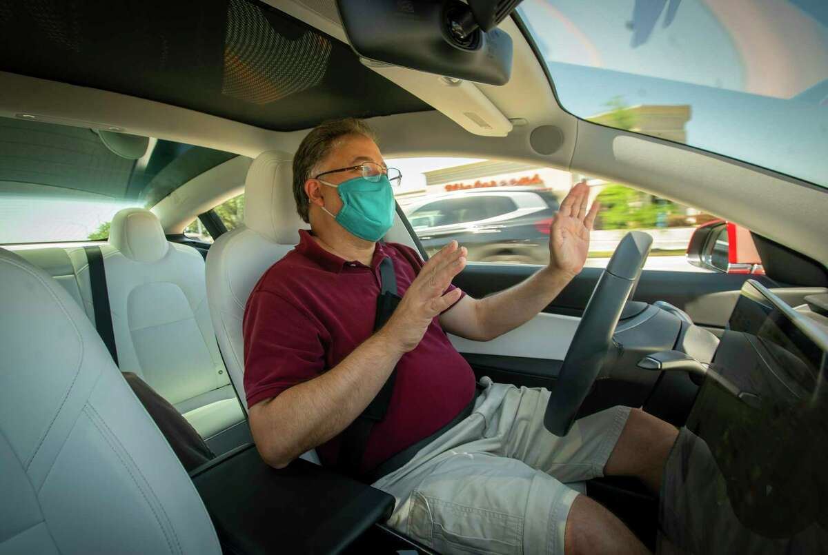 Stephen Pace, founder of the Tesla Owners Group of Houston, demonstrates the capabilities and limitations of the autopilot function in a Tesla Model 3 on Saturday, April 24, 2021, in Houston.
