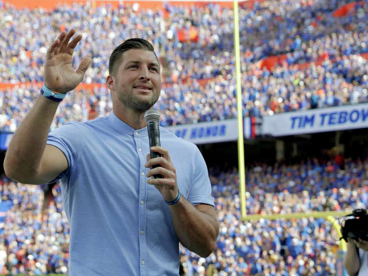 Former Florida football player Tim Tebow speaks to fans after he was inducted in the Ring of Honor at Florida Field in Gainesville, Oct. 6, 2018.