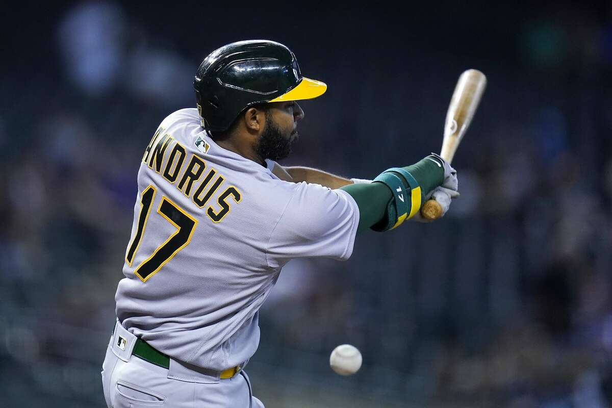 Oakland Athletics' Elvis Andrus fouls off a pitch against the Arizona Diamondbacks during the fourth inning of a baseball game Tuesday, April 13, 2021, in Phoenix. (AP Photo/Ross D. Franklin)
