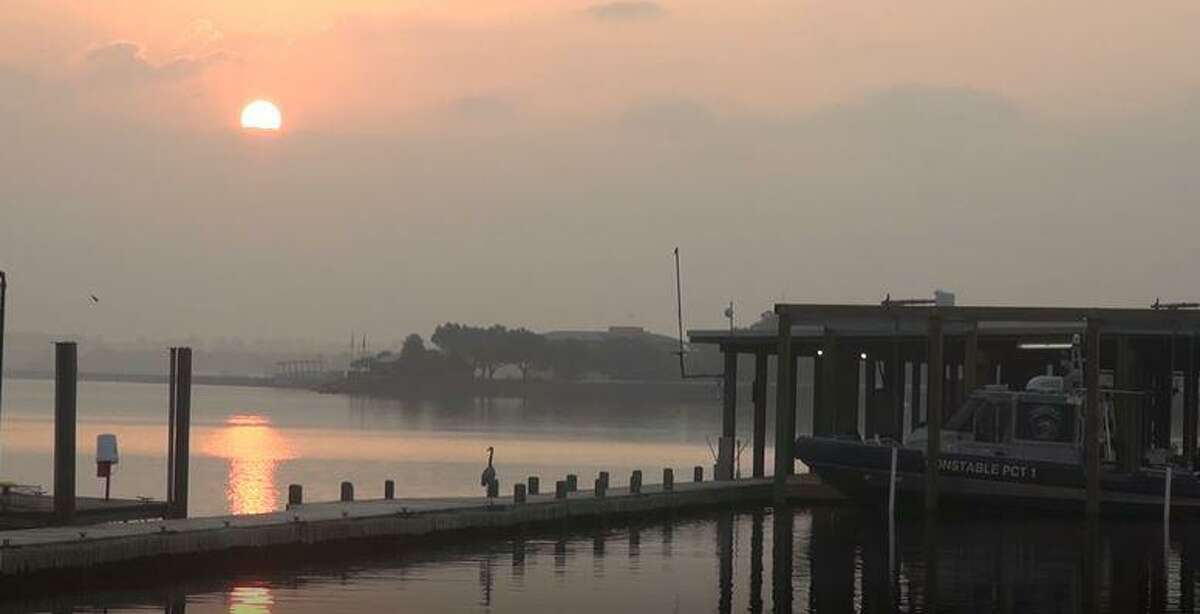 The sun rises over Lake Conroe as Montgomery County Precinct 1 Constable's marine division patrol boats can be seen docked on a pier in the southern part of the body of water. Authorities have recovered the bodies of a couple who drowned together Friday night on Lake Conroe.