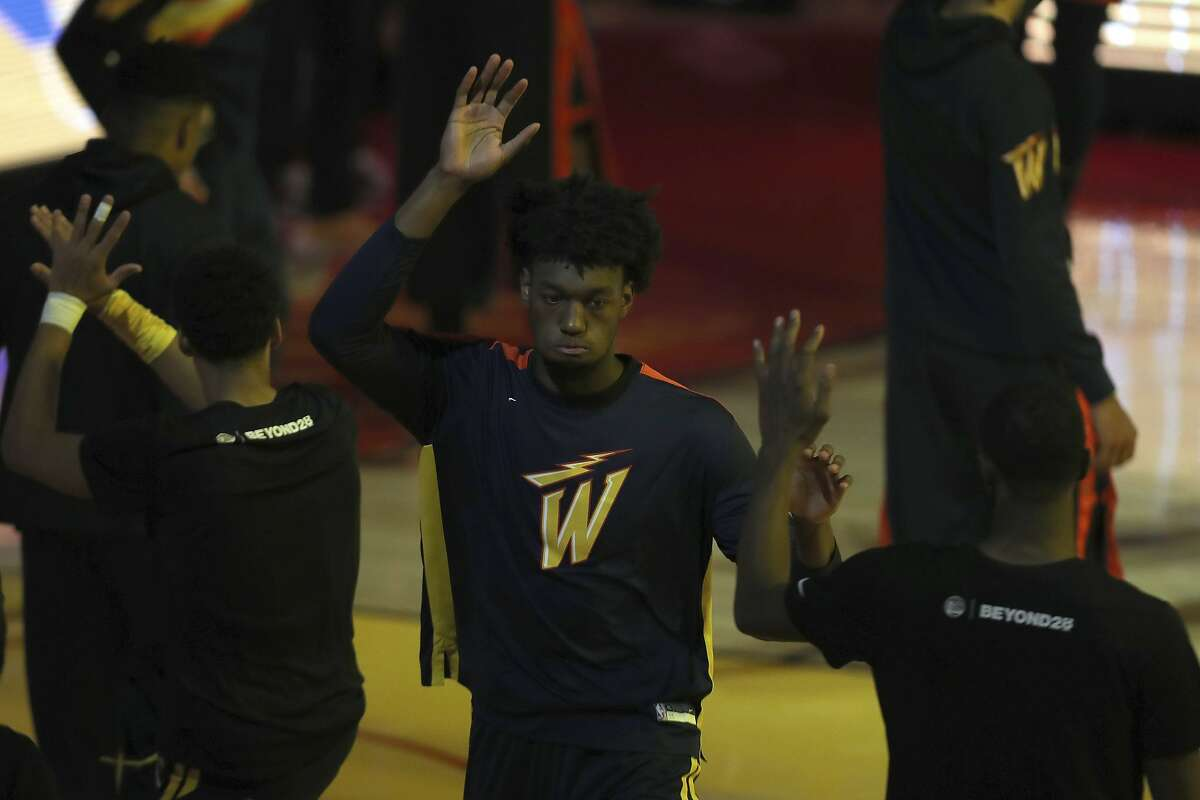Golden State Warriors center James Wiseman is introduced against the Washington Wizards during an NBA basketball game in San Francisco, Friday, April 9, 2021. (AP Photo/Jed Jacobsohn)