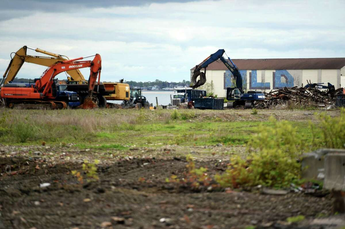 Debris from demolished buildings is cleared for The Haven project on Water Street in West Haven on May 10, 2021.