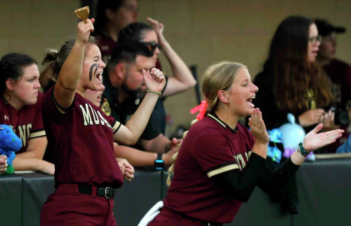 Magnolia players cheer after Alivia Kiser's RBI triple during the second inning in Game 2 of a Region III-5A bi-district softball series at Grand Oaks High School, Friday, April 30, 2021, in Spring.