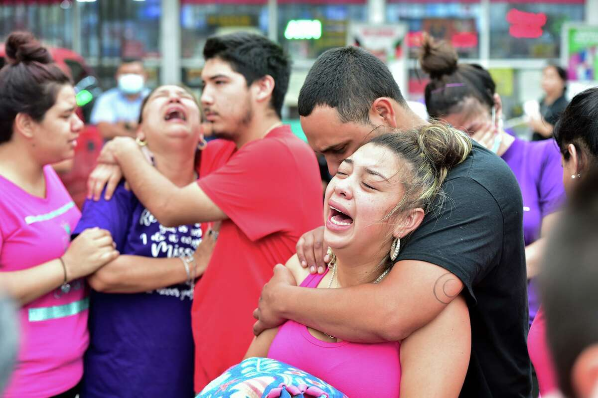 Kassandra Mendoza and Julio Garcia, parents of Saryah Perez, and other family members cry during a rally Monday evening to honor their 6-year-old who was shot and killed Sunday night.