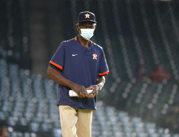 Houston Astros groundskeeper Willie Berry works on the mound before the start of an MLB baseball game at Minute Maid Park, Monday, May 10, 2021, in Houston. Photo: Karen Warren/Staff Photographer / @2021 Houston Chronicle