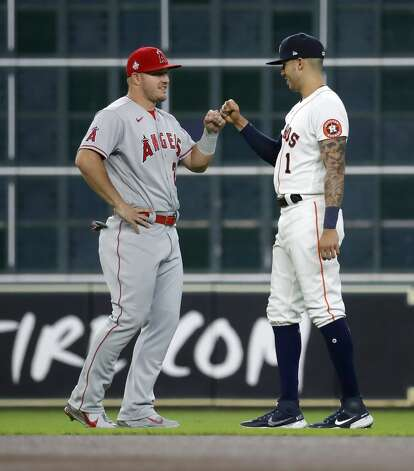 Los Angeles Angels Mike Trout (27) greets Houston Astros Carlos Correa (1) before the start of an MLB baseball game at Minute Maid Park, Monday, May 10, 2021, in Houston. Photo: Karen Warren/Staff Photographer / @2021 Houston Chronicle