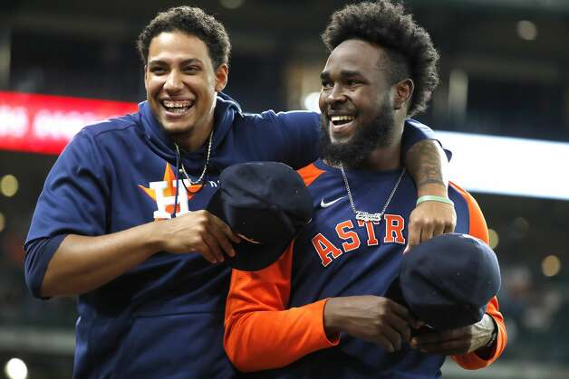 Houston Astros starting pitchers Bryan Abreu hugs Cristian Javier without masks before the start of an MLB baseball game at Minute Maid Park, Monday, May 10, 2021, in Houston. Photo: Karen Warren/Staff Photographer / @2021 Houston Chronicle