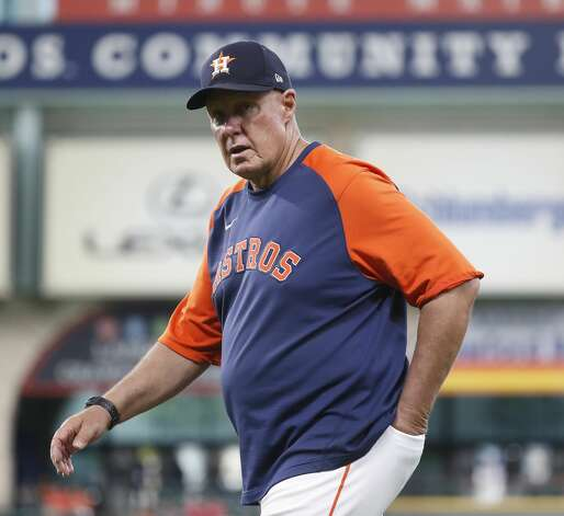 Houston Astros pitching coach Brent Strom (56) walks to the dugout without a mask before the start of an MLB baseball game at Minute Maid Park, Monday, May 10, 2021, in Houston. Photo: Karen Warren/Staff Photographer / @2021 Houston Chronicle