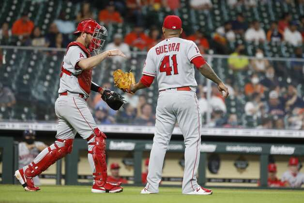 Los Angeles Angels starting pitcher Junior Guerra (41) has a chat with catcher Drew Butera after walking Houston Astros Michael Brantley (during the first inning of an MLB baseball game at Minute Maid Park, Monday, May 10, 2021, in Houston. Photo: Karen Warren/Staff Photographer / @2021 Houston Chronicle