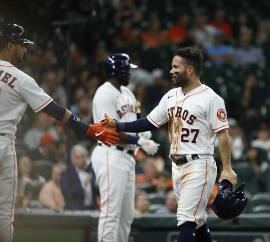 Houston Astros Jose Altuve (27) celebrates his run scored on Alex Bregman's ground-rule double during the first inning of an MLB baseball game at Minute Maid Park, Monday, May 10, 2021, in Houston. Photo: Karen Warren/Staff Photographer / @2021 Houston Chronicle