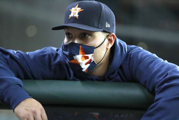 Houston Astros pitcher Andre Scrubb in the dugout wearing a mask before the start of an MLB baseball game at Minute Maid Park, Monday, May 10, 2021, in Houston. Photo: Karen Warren/Staff Photographer / @2021 Houston Chronicle