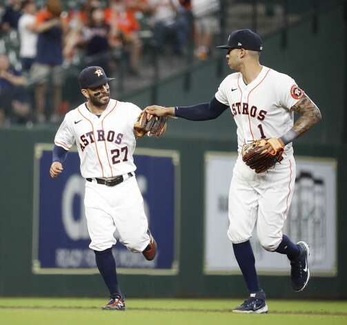 Houston Astros second baseman Jose Altuve (27) celebrates with Carlos Correa after Los Angeles Angels Mike Trout ground out during the first inning of an MLB baseball game at Minute Maid Park, Monday, May 10, 2021, in Houston. Photo: Karen Warren/Staff Photographer / @2021 Houston Chronicle