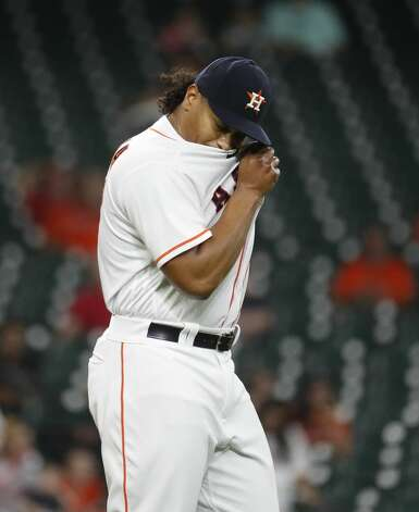 Houston Astros starting pitcher Luis Garcia (77) wipes his face during the second inning of an MLB baseball game at Minute Maid Park, Monday, May 10, 2021, in Houston. Photo: Karen Warren/Staff Photographer / @2021 Houston Chronicle