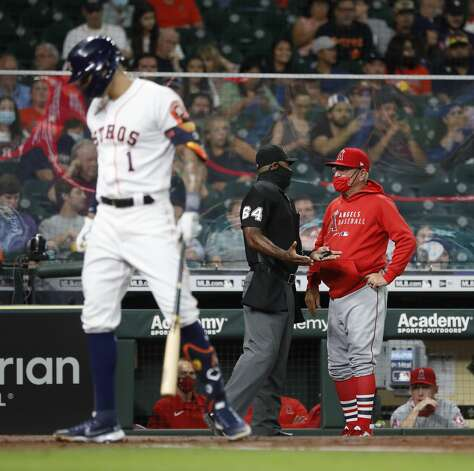 Los Angeles Angels manager Joe Maddon talks with home plate umpire Alan Porter as Houston Astros Carlos Correa (1) batted during the first inning of an MLB baseball game at Minute Maid Park, Monday, May 10, 2021, in Houston. Photo: Karen Warren/Staff Photographer / @2021 Houston Chronicle