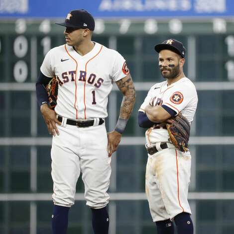 Houston Astros second baseman Jose Altuve (27) and shortstop Carlos Correa (1) wait for the review after he tried to get Los Angeles Angels Taylor Ward out on a grounder during the second inning of an MLB baseball game at Minute Maid Park, Monday, May 10, 2021, in Houston. Photo: Karen Warren/Staff Photographer / @2021 Houston Chronicle