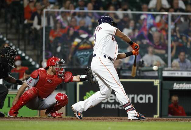 Houston Astros Michael Brantley (23) hits an RBI double during the second inning of an MLB baseball game at Minute Maid Park, Monday, May 10, 2021, in Houston. Photo: Karen Warren/Staff Photographer / @2021 Houston Chronicle