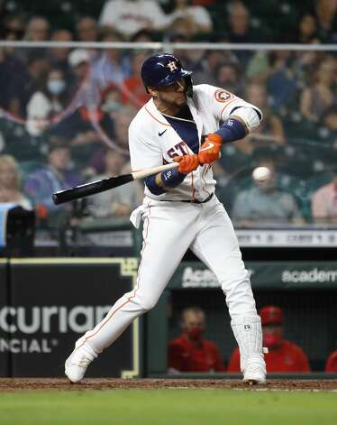 Houston Astros Yuli Gurriel (10) singles off of Los Angeles Angels relief pitcher Jose Suarez during the third inning of an MLB baseball game at Minute Maid Park, Monday, May 10, 2021, in Houston. Photo: Karen Warren/Staff Photographer / @2021 Houston Chronicle