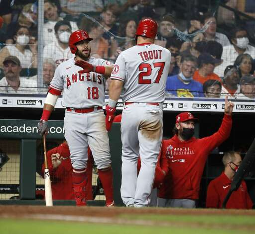 Los Angeles Angels Mike Trout (27) celebrates his run scored with Jose Rojas (18) on Jared Walsh's RBI double during the fourth inning of an MLB baseball game at Minute Maid Park, Monday, May 10, 2021, in Houston. Photo: Karen Warren/Staff Photographer / @2021 Houston Chronicle
