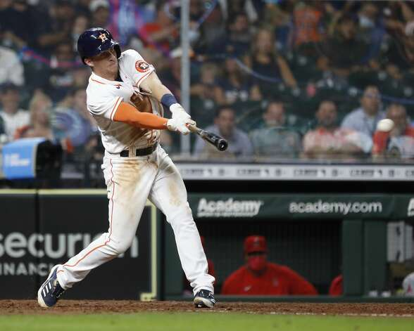 Houston Astros Myles Straw (3) hits an RBI double off of Los Angeles Angels relief pitcher Jose Suarez during the fifth inning of an MLB baseball game at Minute Maid Park, Monday, May 10, 2021, in Houston. Photo: Karen Warren/Staff Photographer / @2021 Houston Chronicle