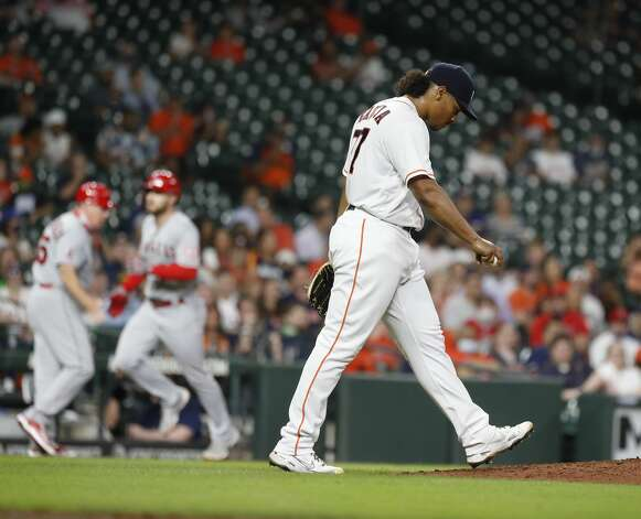 Houston Astros starting pitcher Luis Garcia (77) reacts as Los Angeles Angels Jared Walsh rounds the bases after hitting a home run off of him during the sixth inning of an MLB baseball game at Minute Maid Park, Monday, May 10, 2021, in Houston. Photo: Karen Warren/Staff Photographer / @2021 Houston Chronicle