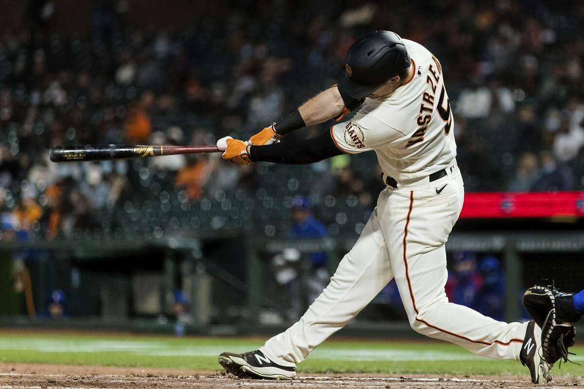 San Francisco Giants' Mike Yastrzemski (5) hits a double against the Texas Rangers during the sixth inning of a baseball game in San Francisco, Monday, May 10, 2021. (AP Photo/John Hefti)