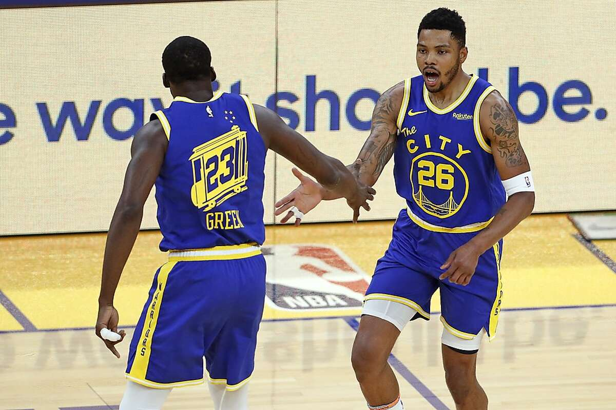 Golden State Warriors' Kent Bazemore celebrates a 3-pointer with Draymond Green while playing Utah Jazz during 1st quarter of NBA game at Chase Center in San Francisco, Calif., on Monday, May 10, 2021.