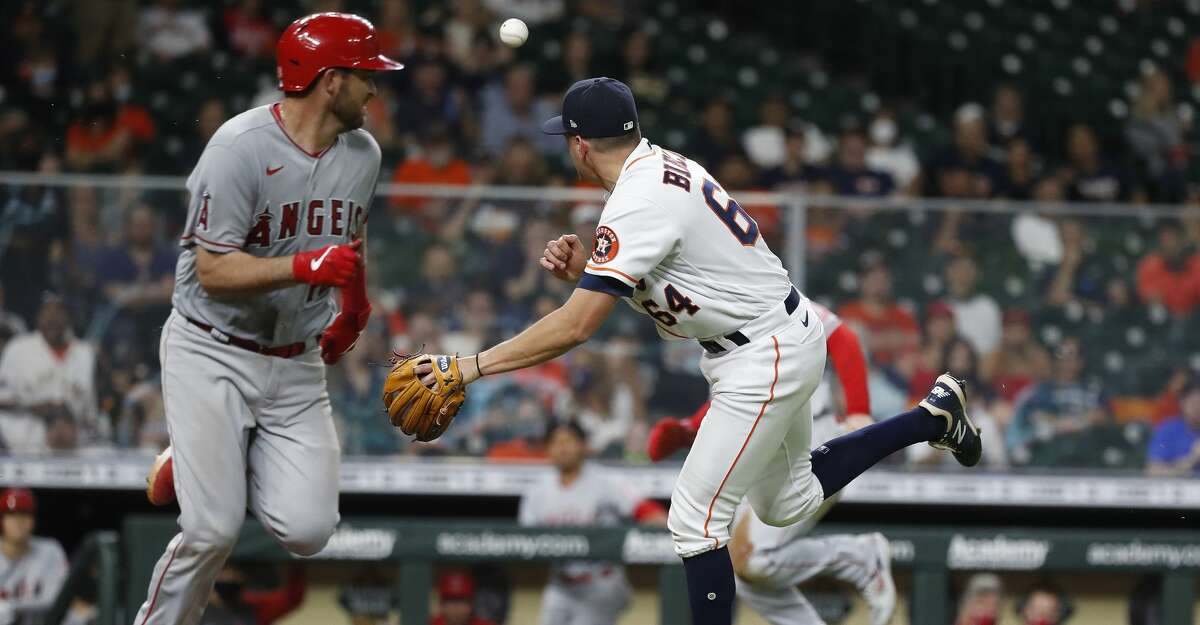 Houston Astros relief pitcher Brandon Bielak (64) tries to field Los Angeles Angels Drew Butera's sacrifice bunt during the sixth inning of an MLB baseball game at Minute Maid Park, Monday, May 10, 2021, in Houston.